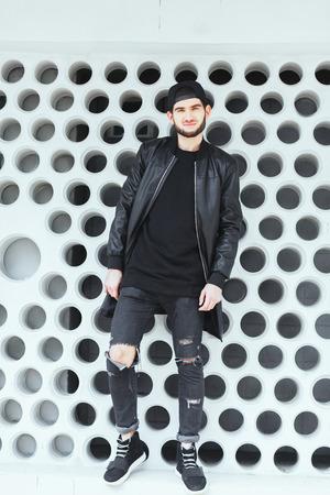 Boy standing near wall