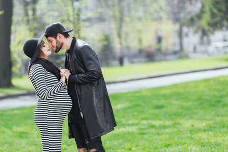 Man and pregnant girl in park