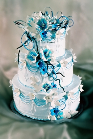 Beautifully decorated wedding cake with blue flowersの写真素材