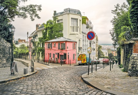photo of a street in Montmartre, Paris, France, in a warm light and light toning