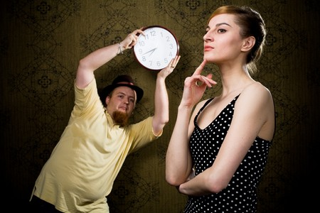 An image of a man with a clock and a nice woman
