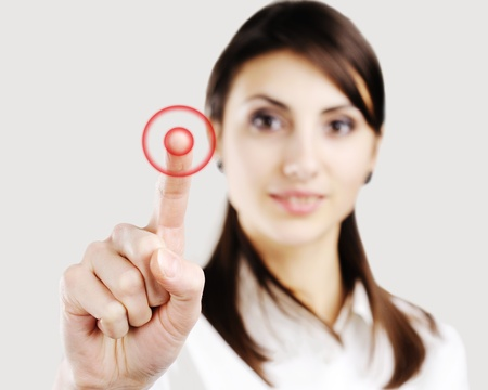 Young business woman pointing at something on screen