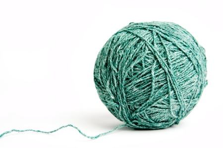 An image of a ball of green yarn on white background