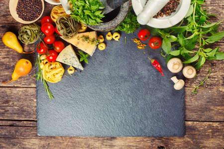 Italian food, pasta, cheese, vegetables and spices. Food background with copyspace