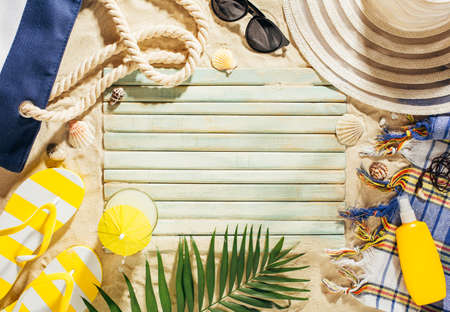 Summer vacation template background with empty space and beach accessories on the sand