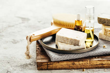 Foto de Spa composition with natural homemade soap, towels and aroma oil. Selective focus. - Imagen libre de derechos