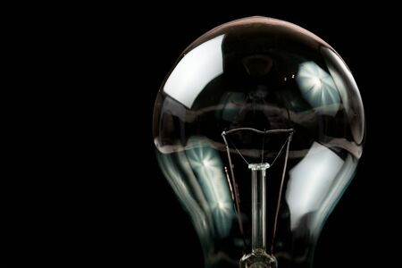 Photo for Incandescent light bulb on a black background - Royalty Free Image