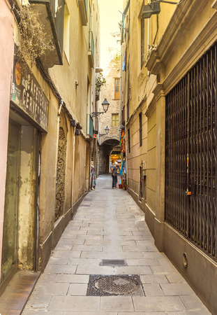 BARCELONA, SPAIN - JULY 6, 2015: A street from the Gothic Quarter (Barri gotic) of Barcelona.