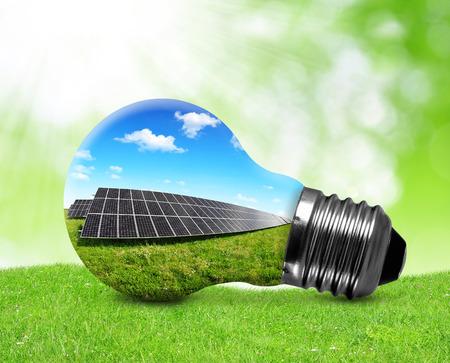 Foto de Solar panels in light bulb. Green energy concept.  - Imagen libre de derechos