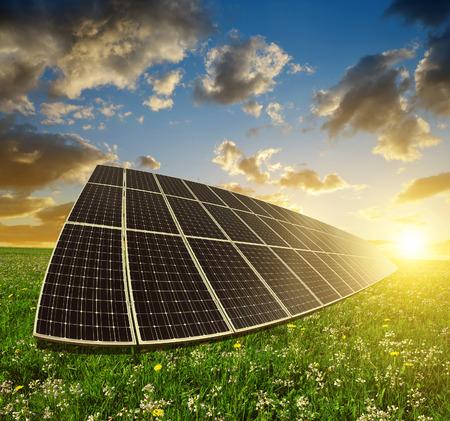 Foto de Solar energy panels against sunset sky.Clean energy. - Imagen libre de derechos