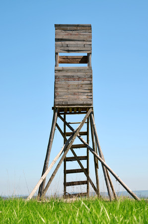 Lookout tower for hunting on meadow.