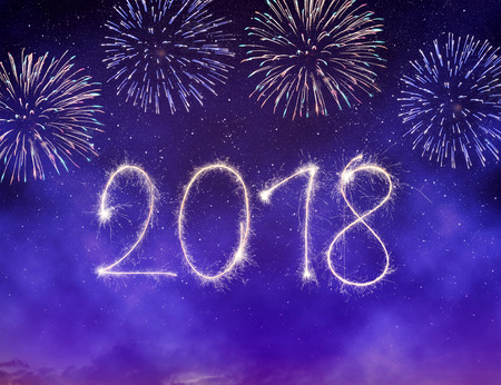 Photo pour Fireworks in the night sky. Celebrating the New Year 2018. - image libre de droit