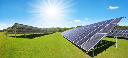 Photo for Solar energy panels on meadow with sunny sky. Sustainable resources. - Royalty Free Image