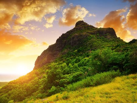 Le Morne Brabant mountain on the south of Mauritius island. Tropical landscape at sunset.