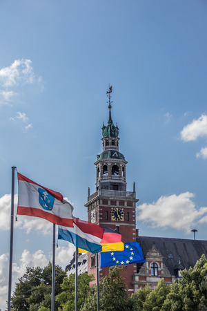 Flags in front of the Rathaus in Leer, Germany