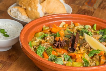 Moroccan tagine dish with chick peas, lamb, carrots, celery, lemon, onion, cinnamon, star anise