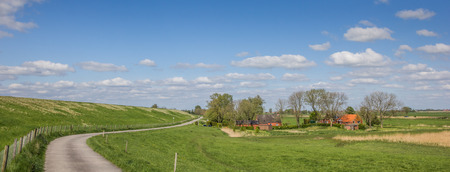 Panorama of a bicycle path along the dollard route in Ostfriesland, Germany
