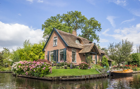 House and garden at the central canal of Giethoorn, Holland