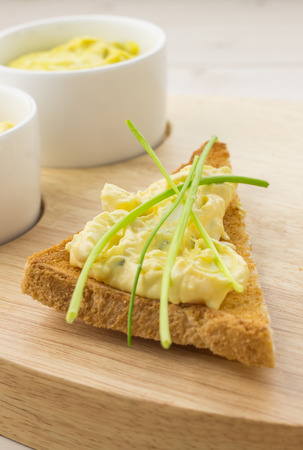 Toasted bread with egg and chive salad