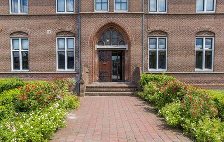 Photo pour Front door of the historic monastery in Hoogeveen, Netherlands - image libre de droit