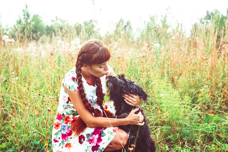 Beautiful woman playing with her dog. Outdoor portrait. series