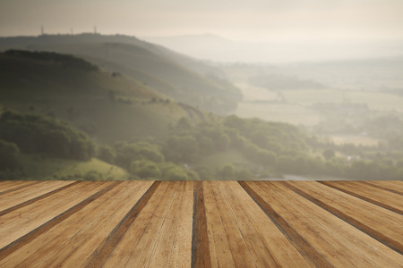 English countryside landscape during late Summer afternoon with dramatic sky and lighting with wooden planks floor