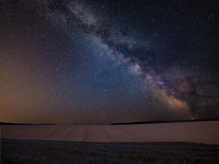 Photo pour Stunning vibrant Milky Way composite image over landscape of wheat field in Summer - image libre de droit