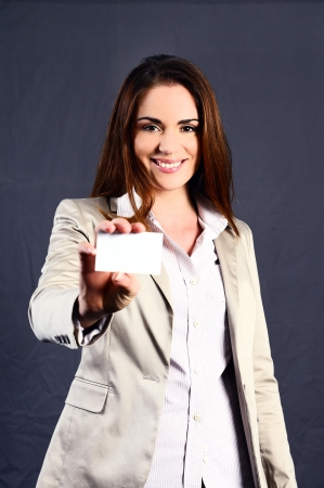 executive and attractive caucasian woman with a buisiness card