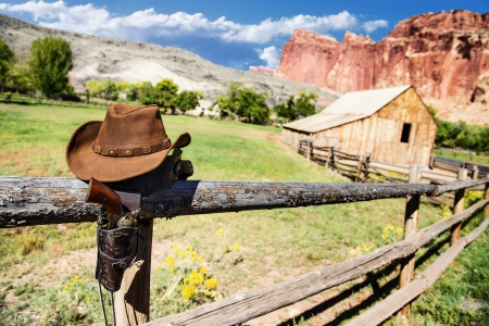 hat and gun in the far west,