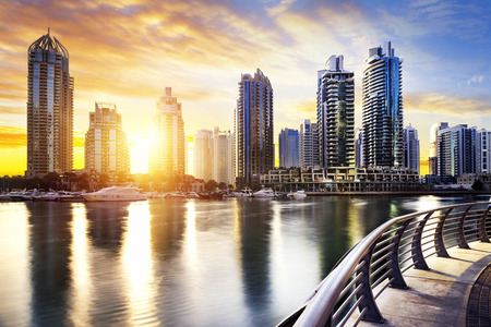 Photo pour skyline of Dubai Marina with boats at night United Arab Emirates Middle East - image libre de droit