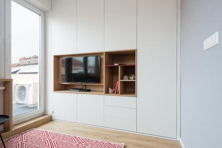 BRATISLAVA, SLOVAKIA - DEC 17, 2018: Living room area of small apartment designed by young interior designers from Kivvi architects based in Bratislava, Slovakia
