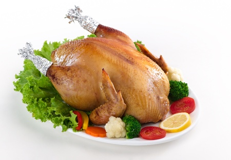 Eatable whole roasted chicken served with vegetable