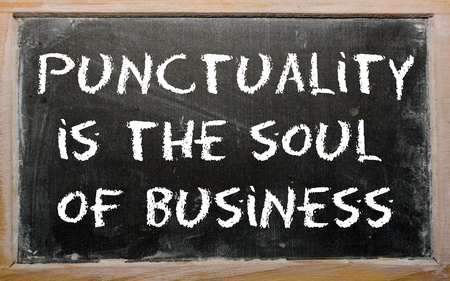 Blackboard writings &quot,Punctuality is the soul of business&quot,