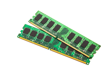 Two green strips of RAM for a computer, isolated
