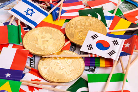 Photo for Bitcoins coin on the background of flags of different countries close up - Royalty Free Image