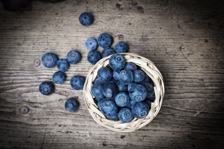 fresh blueberries on an old table - still life