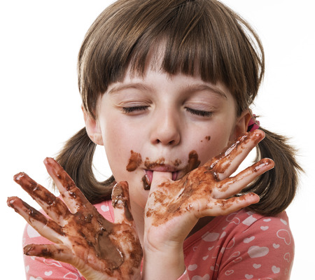 little girl eating a chocolate