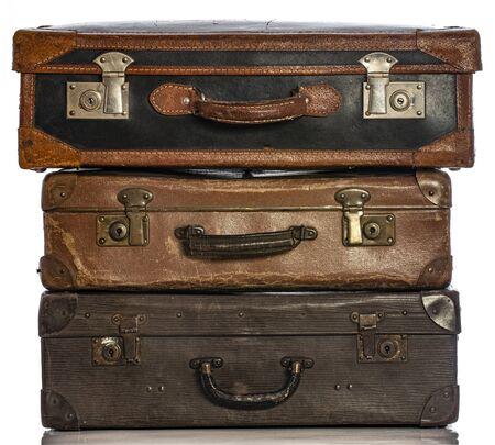 Photo pour Old brown suitcases on a white background - image libre de droit