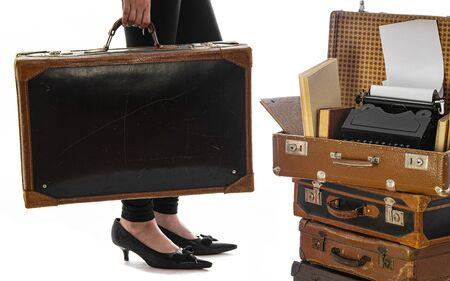 Photo pour young girl with an old suitcase isolated on a white background - image libre de droit
