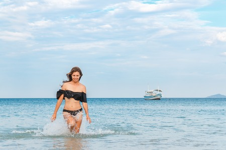 Photo for beautiful girl standing waist-high in the sea. - Royalty Free Image