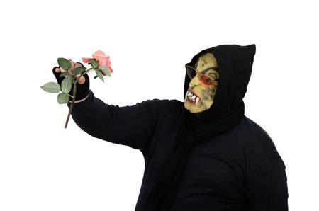 Monster looks at flower