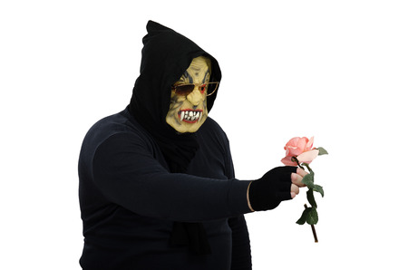 Monster examines a rose so carefully