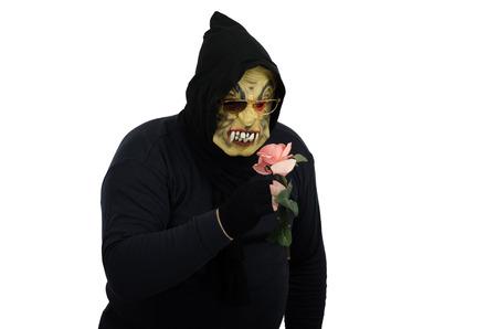Monster smelling a rose