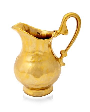 Golden jug isolated on white background