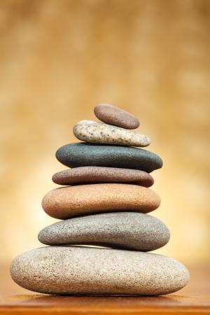 Stack of zen stones over brown background