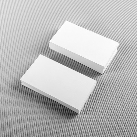 Photo pour Photo of blank business cards with soft shadows on gray background. Template for ID. Top view. - image libre de droit