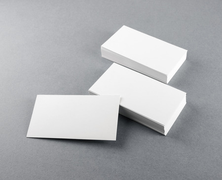 Photo pour Photo of blank business cards with soft shadows on gray background. Template for branding identity. - image libre de droit