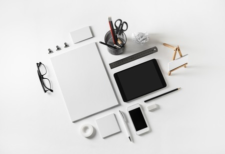 Foto de Corporate identity template on white paper background. Photo of blank stationery set. Mockup for design presentations and portfolios. Flat lay. - Imagen libre de derechos