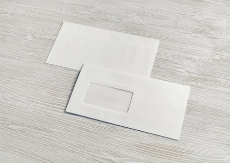 Photo pour Blank paper envelopes on light wood table background. Back and front. Mockup for placing your design. - image libre de droit