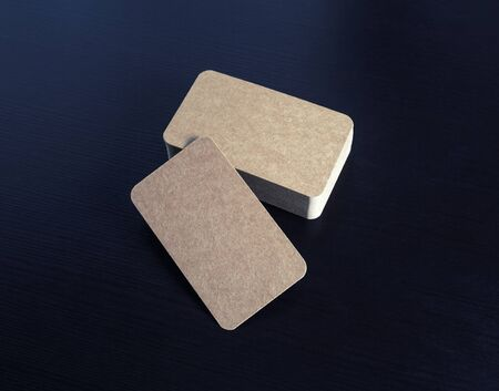 Photo pour Blank kraft business cards on black wood table background. Template for branding ID. - image libre de droit